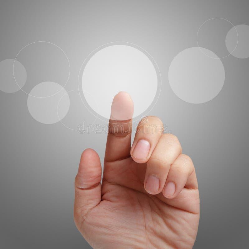 Point mâle de main sur la surface adjacente d'écran tactile photographie stock