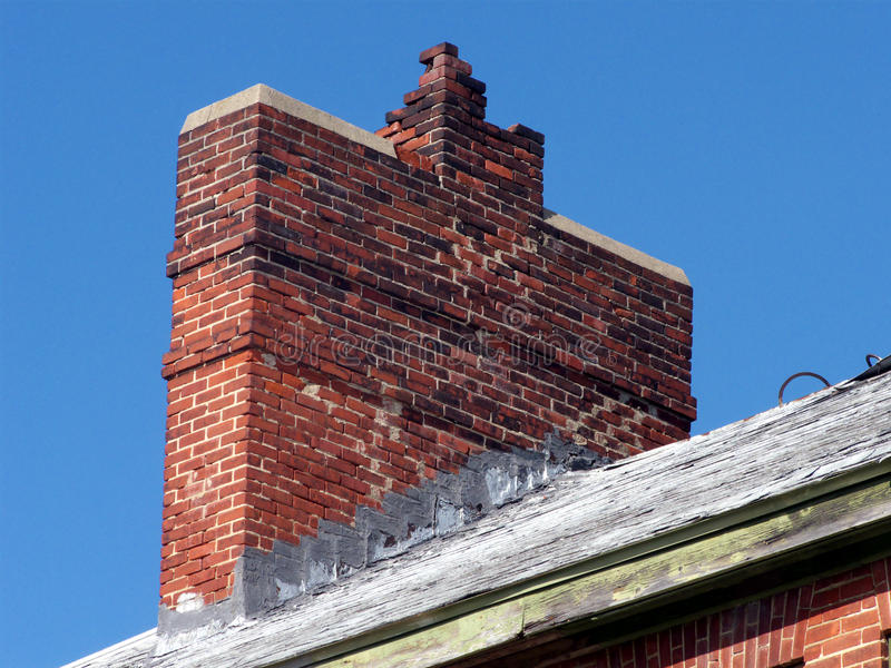 Point Me to a Tuckpointer. Masonry chimney in disrepair, sorely in need of pointing and/or tuckpointing royalty free stock image