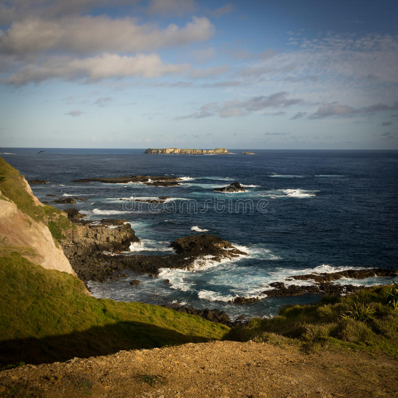 Point Ross, Norfolk Island. The view from Point Ross, Norfolk Island, Australia highlighting the reefs surrounding the island stock images