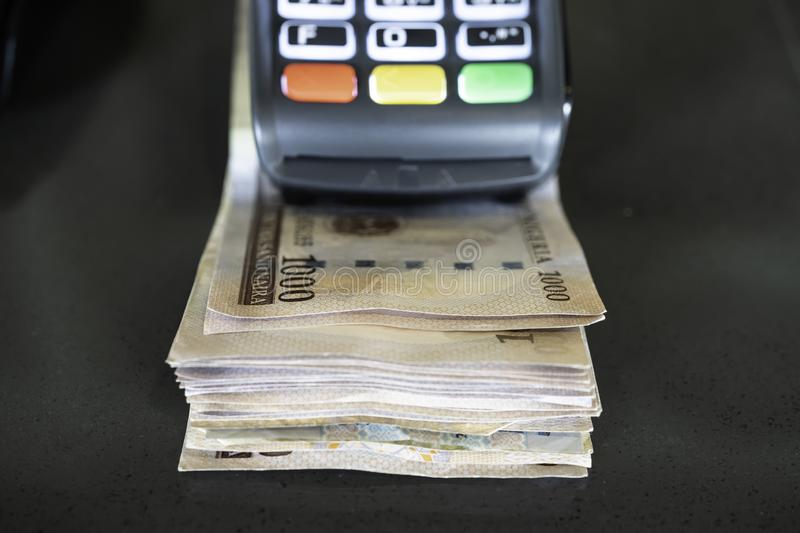 Point of Sale Machine with Nigerian Naira notes royalty free stock photo