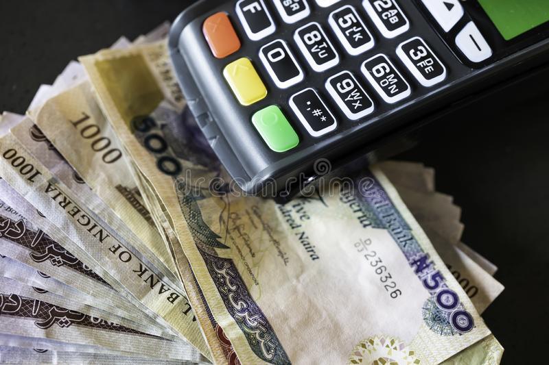 Point of Sale Machine with Nigerian Naira notes royalty free stock photography