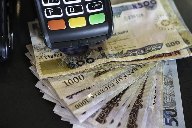 Point of Sale Machine with Nigerian Naira notes stock image