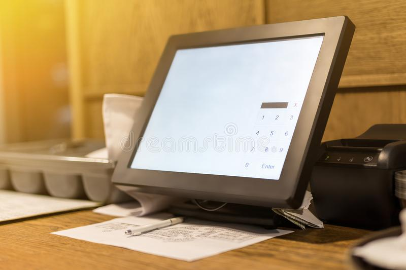 Point of sale POS touchscreen terminal. Tablet computer for waiter to make and send orders. White empty screen with royalty free stock photo