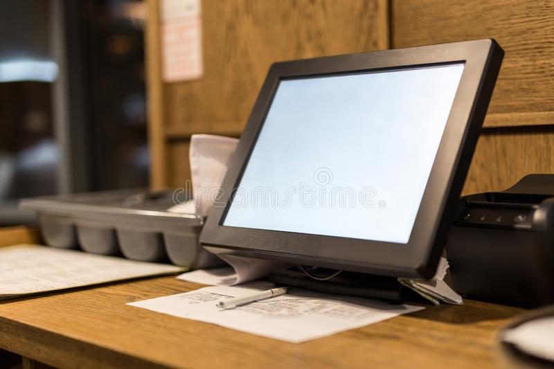 Point of sale POS touchscreen terminal. Tablet for waiter to make and send orders. Cafe administrator table with mobi. Le printer and hall scheme. White empty stock photography