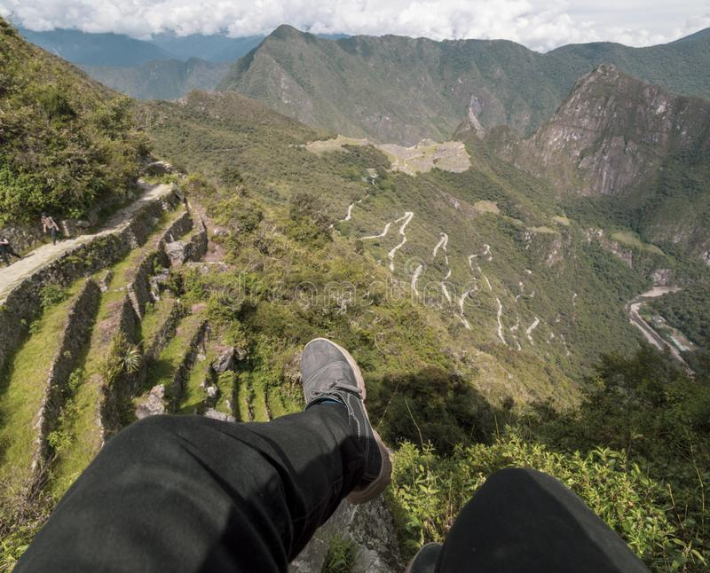 Point of view,pointing hand, Machu Picchu and Huayna Picchu mountain in Peru, seen from the door of the sun. Background, cusco, tree, cloud, forest, culture stock images