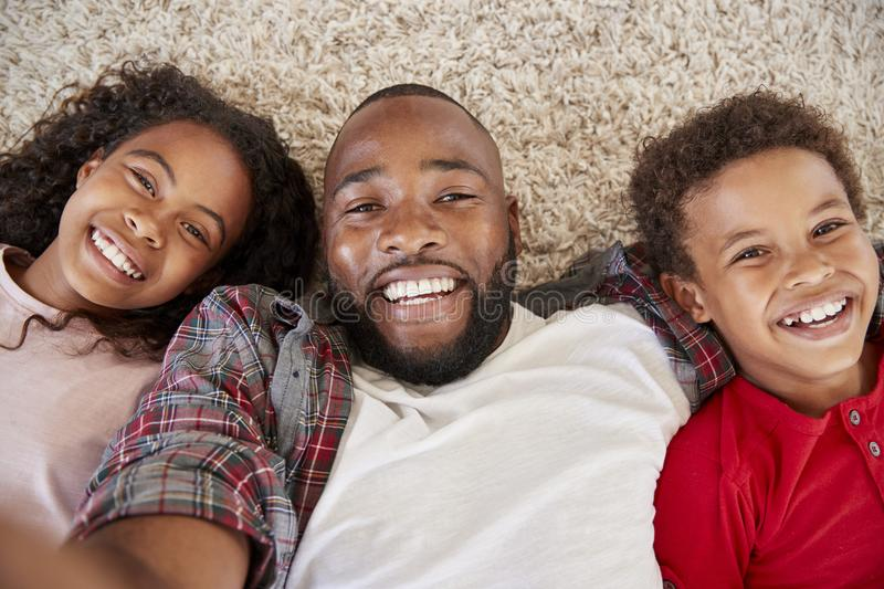 Point Of View Shot Of Father And Children Posing For Selfie royalty free stock image