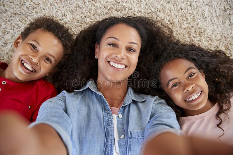 Point Of View Shot Of Mother And Children Posing For Selfie royalty free stock photography