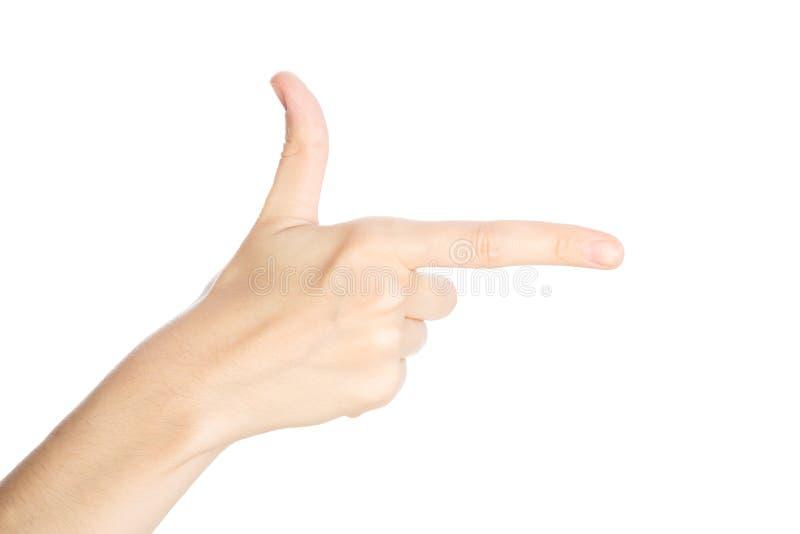 Pointage du geste La main femelle montre l'index sur un isolat blanc de fond photographie stock