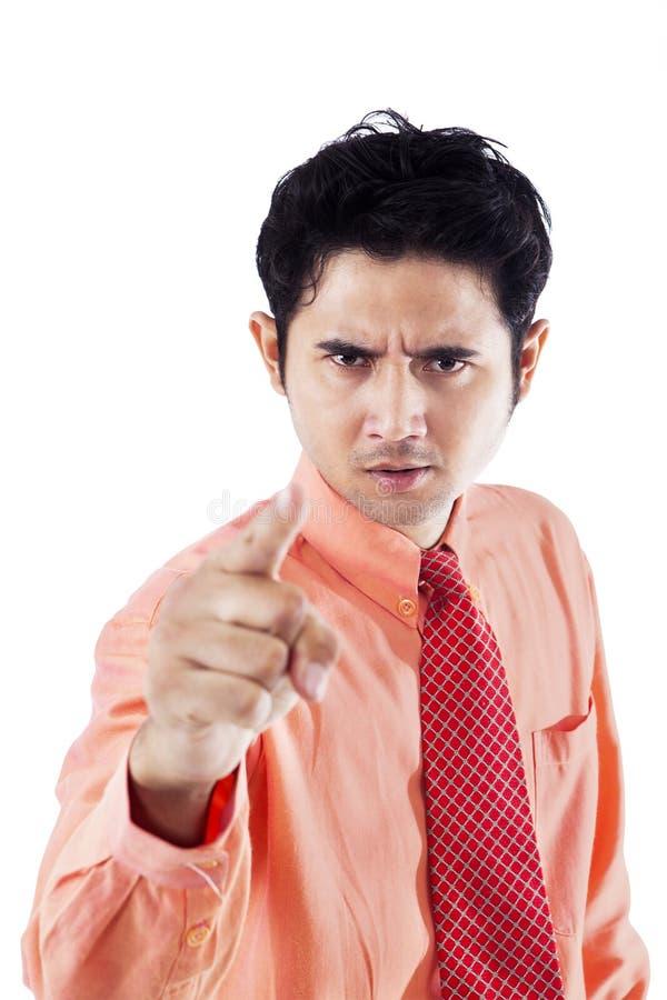 Pointage fâché d'homme d'affaires images libres de droits