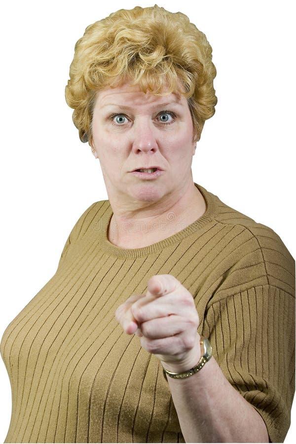 Pointage fâché de femme image libre de droits