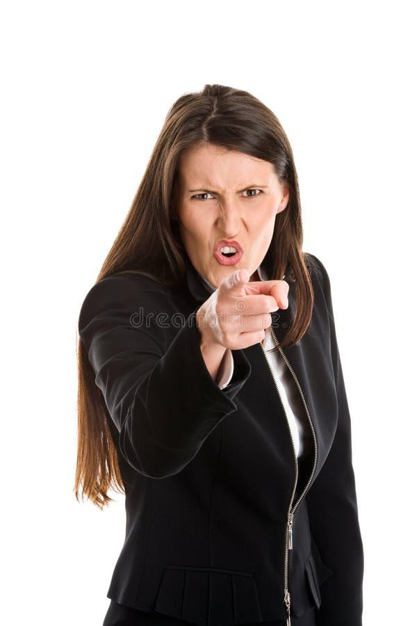 Pointage fâché de femme d'affaires photos stock