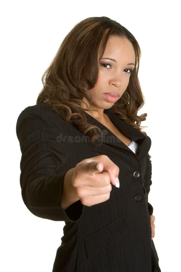 Pointage fâché de femme d'affaires photo stock
