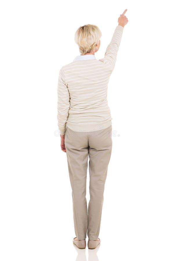 Pointage supérieur de femme de vue arrière photographie stock