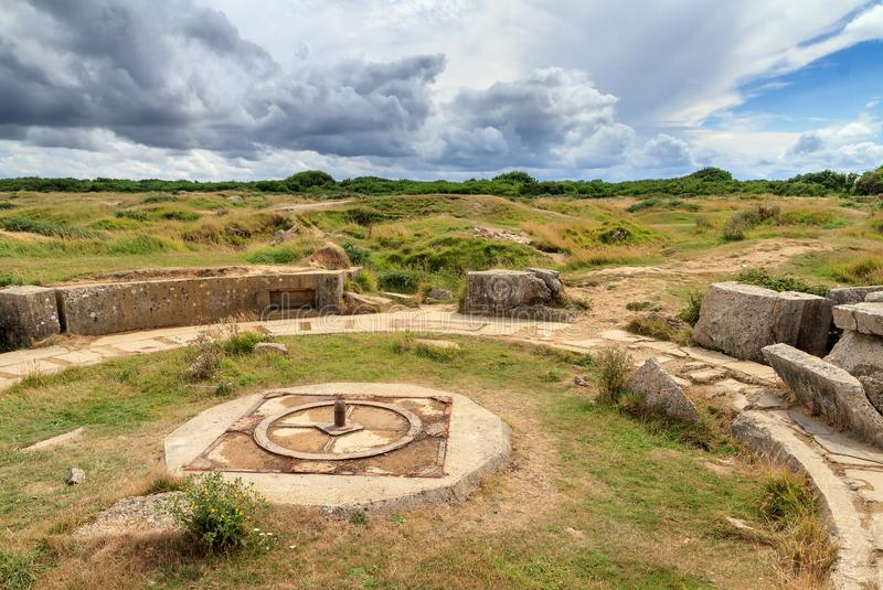Pointe du Hoc bunkers. Beautiful view of the remains of German bunkers at the Pointe du Hoc in the dunes of Normandy, France, a WW2 memorial site stock photography