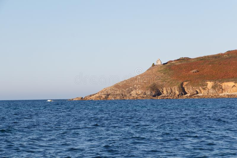 Pointe du Mouton and coast in Plogoff. During a sunny day stock photography