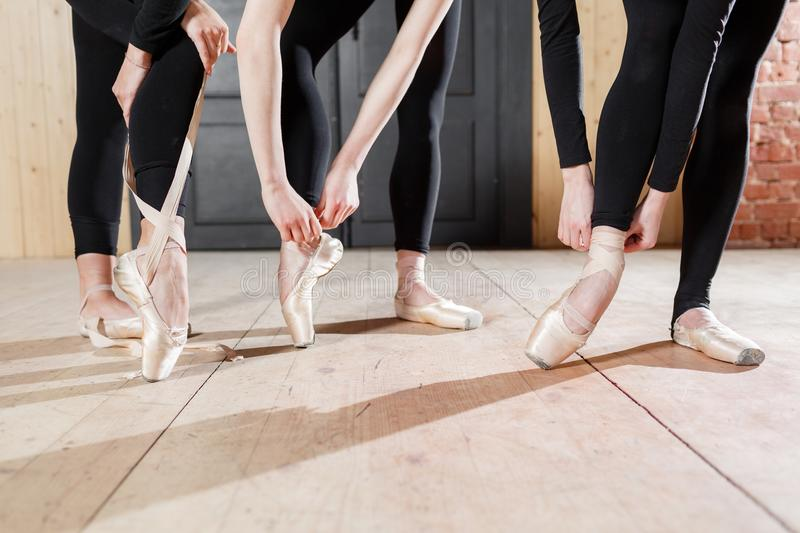 Pointe shoes close up. Young ballerina girls. Women at the rehearsal in black bodysuits. Prepare a theatrical. Young ballerina girls. Women at the rehearsal in royalty free stock photos