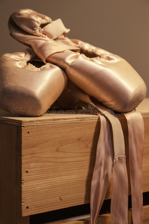 Pointe shoes in dramatic lighting stock image
