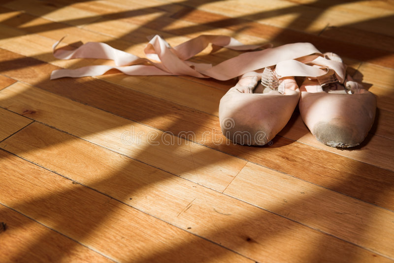 Pointe Shoes on studio floor royalty free stock photo