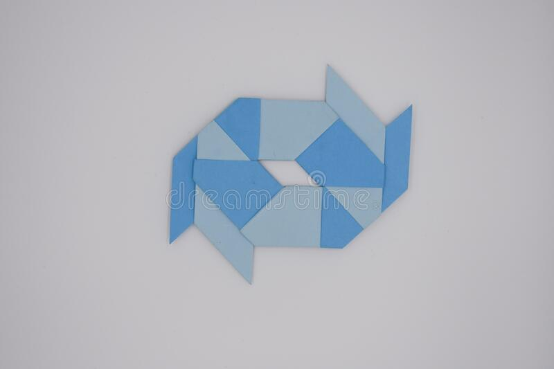 8 pointed ninja star paper fold. One blue paper fold of 8 pointed ninja star was taken stock photos