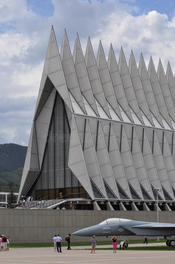 Air Force Academy Cadet Chapel. The pointed spires of the Air Force Academy Cadet Chapel rise above visitor, tourists, and a fighter plane royalty free stock images