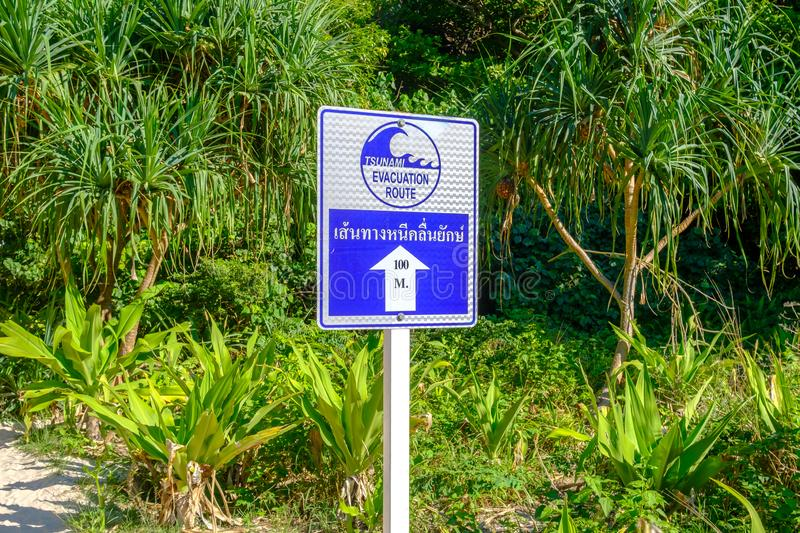 Pointer indicating the direction for evacuation from tsunami. Warning sign: Tsunami evacuation route.  royalty free stock photos