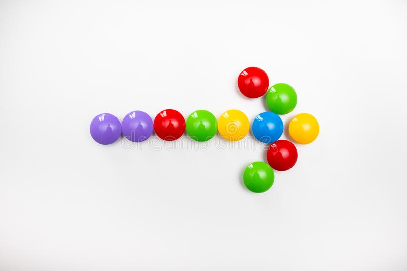 A pointing arrow made from children`s toys. Multicolored figures for games.  stock images