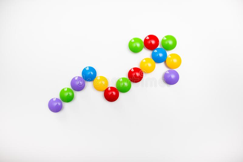 A pointing arrow made from children`s toys. Multicolored figures for games.  stock image