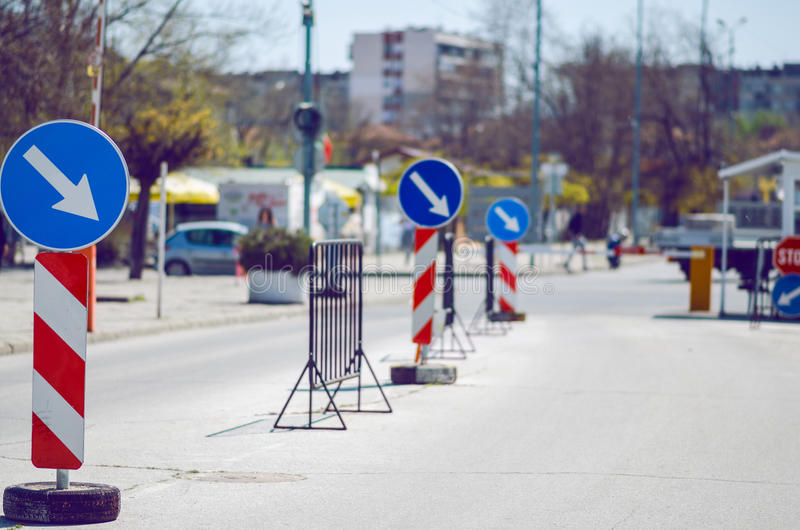 Pointing Arrow And Stop Signs. Showing The Way To Drivers On The Street stock photography