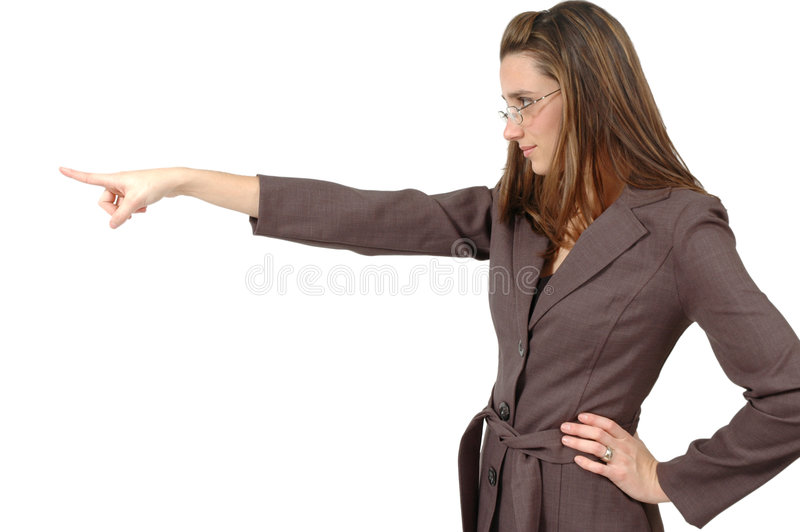 Pointing with attitude. Business woman with glasses points with attitude and looks in the same direction royalty free stock photo