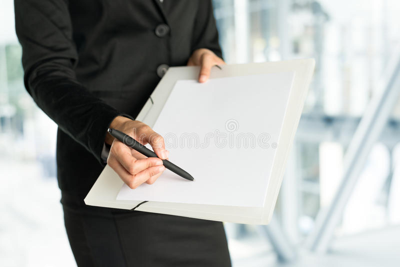 Pointing business data in blank sheet royalty free stock photography