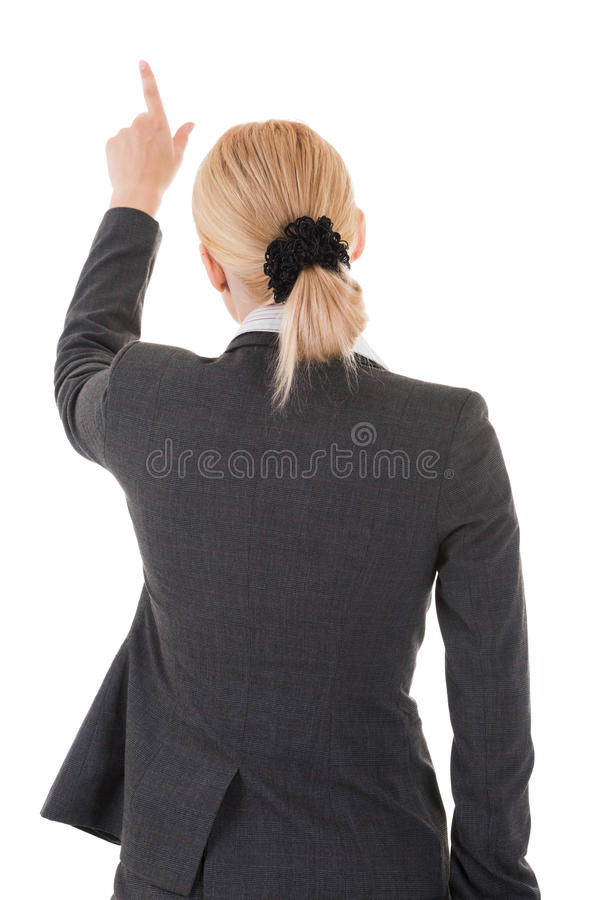 Pointing business woman from back. Isolated on white background royalty free stock photos