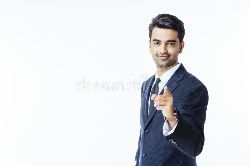Pointing at camera, handsome businessman royalty free stock photography
