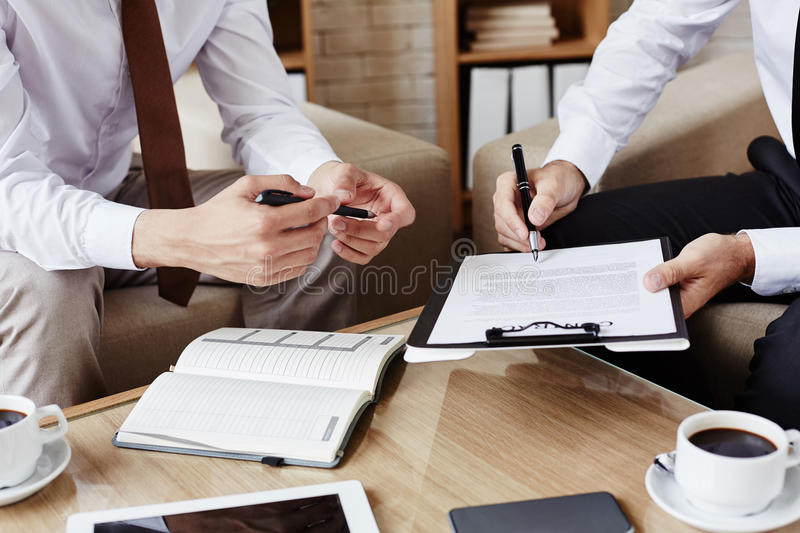 Pointing at contract stock image