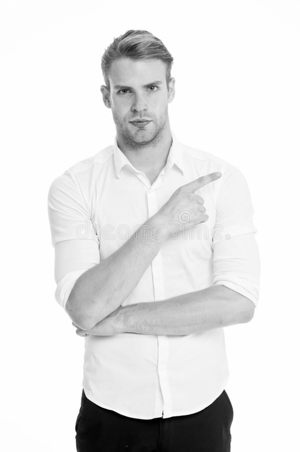 Pointing direction. Man shop assistant pointing index finger isolated on white. Manager or assistant help find direction royalty free stock photo