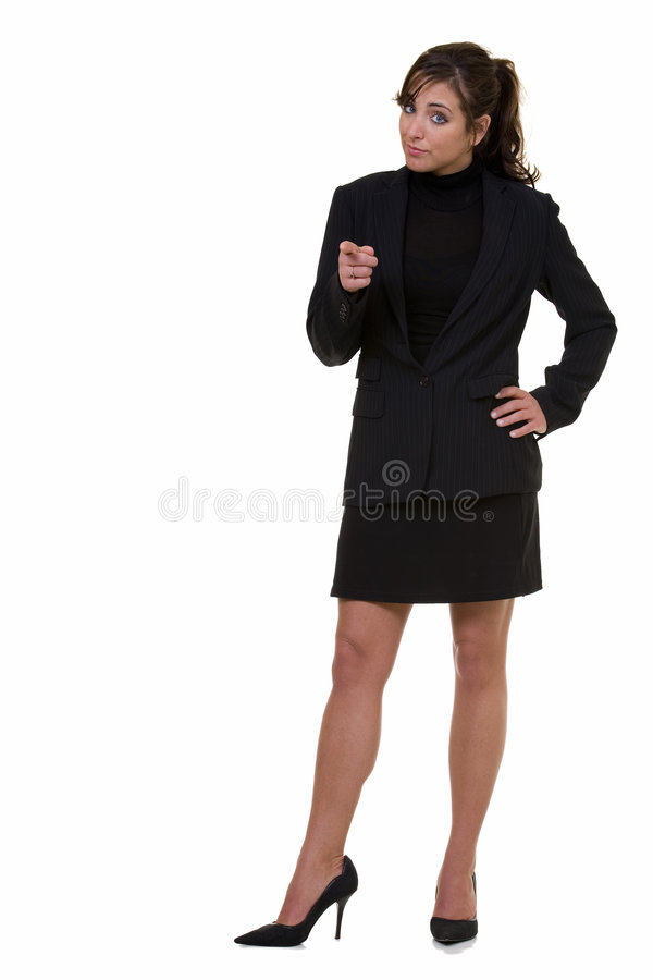 Pointing the finger. Full body of an attractive brunette business woman pointing forward standing on white stock photography