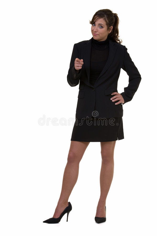 Pointing the finger. Full body of an attractive brunette business woman pointing forward standing on white stock image