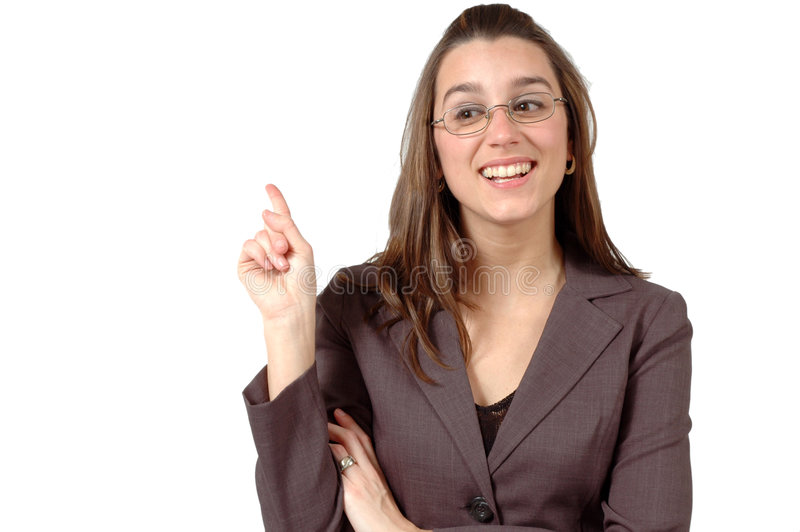 Pointing Finger. Business woman with glasses is pointing her finger behind her. You can use this white space for your own advertising royalty free stock photos