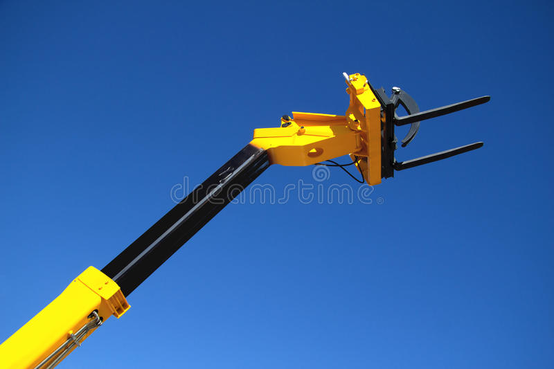 Pointing forklift against the sky royalty free stock images