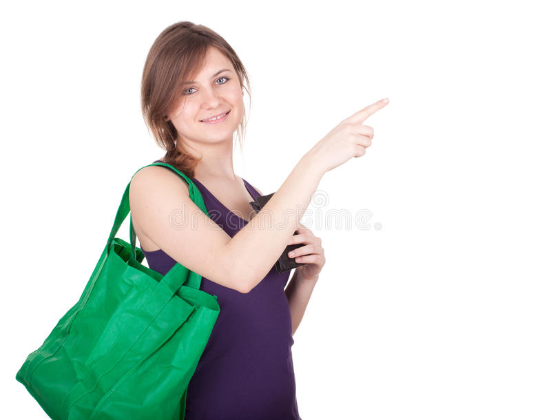 Pointing girl with shopping bag