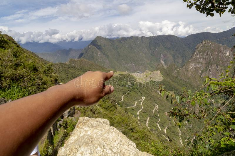 Pointing hand, Machu Picchu and Huayna Picchu mountain in Peru, seen from the door of the sun. Background, cusco, tree, cloud, forest, culture, america stock image