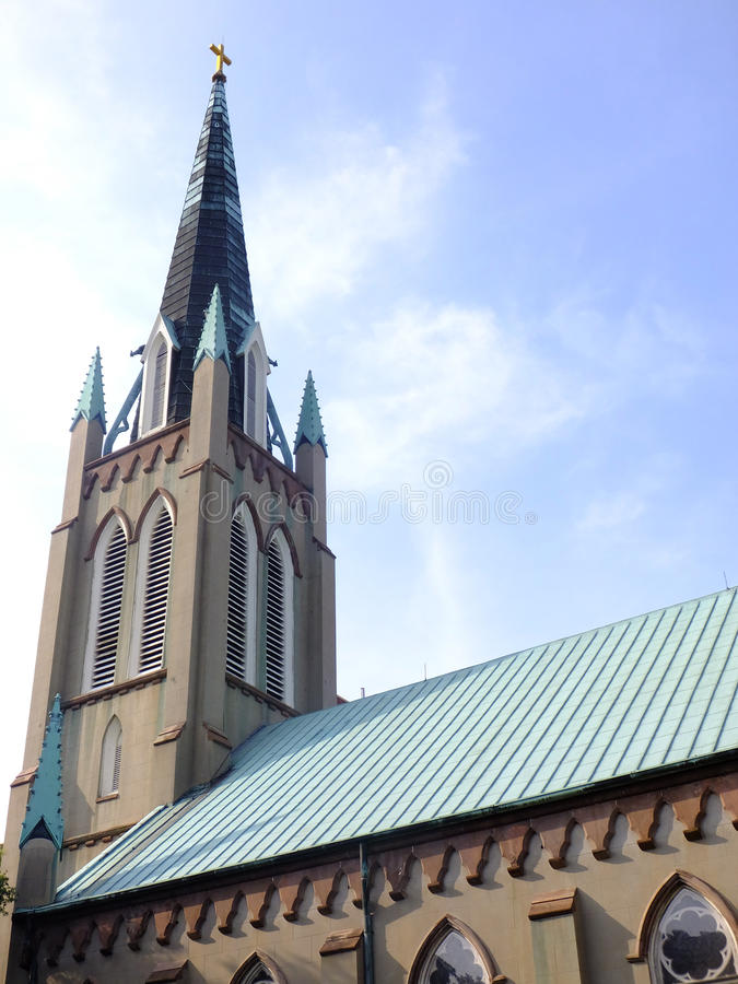 Pointing Heavenward. Old Christian church with multiple spires pointing upward into the blue sky, a gold cross atop the tallest one royalty free stock photos