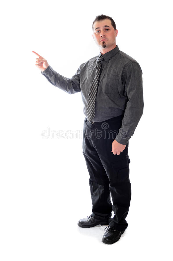 Pointing to the left. Man in suit raised eyebrows. Man in suit pointing to the left toward product placement royalty free stock images