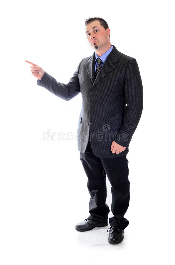 Pointing to the left. Man in suit. Man in suit pointing to the left toward product placement royalty free stock image