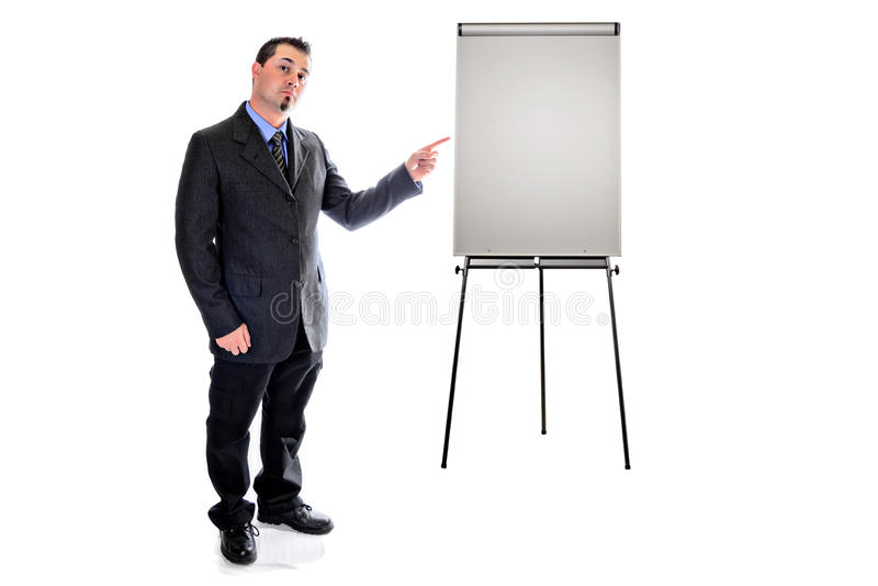 Pointing to presentation easel. man in suit. Man in suit pointing to presentation easel stock image