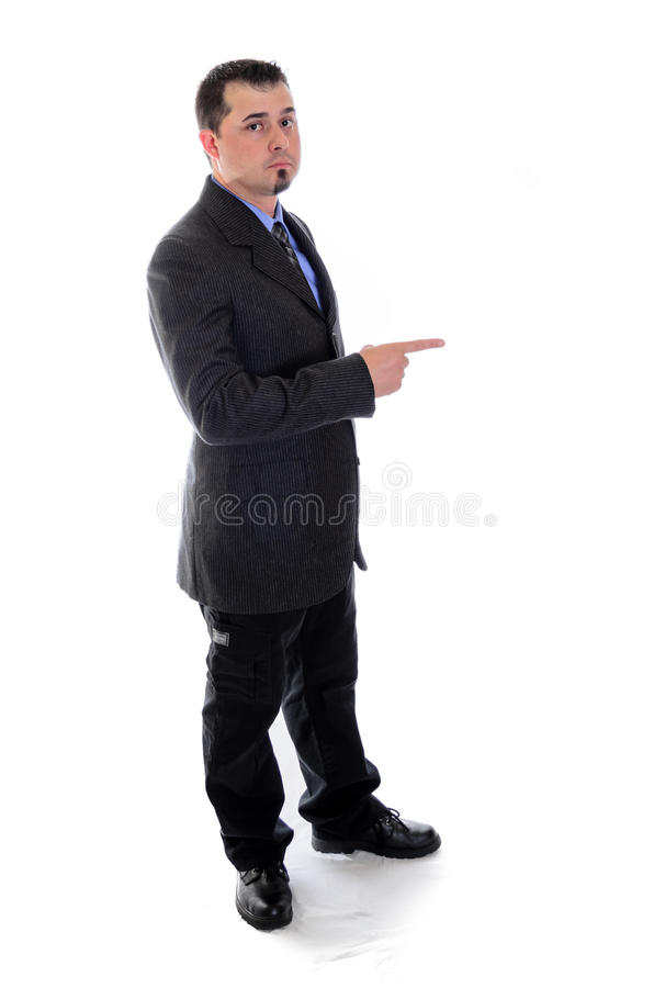 Pointing to the right. Man in suit. Man in suit pointing to the right toward product placement stock photography