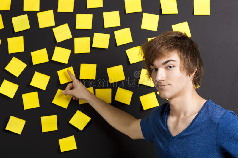Download Pointing to a yellow note stock photo. Image of lifestyle - 23689292