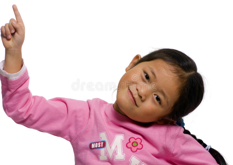 Pointing upward 2. A young girl points upward at something stock image