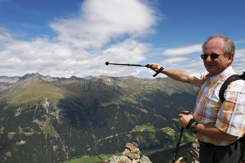 Pointing at wonderful landscape in the Alps