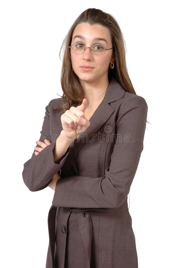 Pointing at you. Business woman with glasses points her finger at you royalty free stock photography