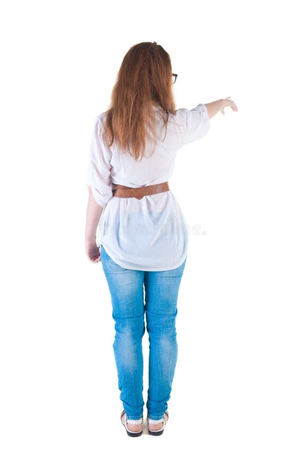 Points de jeune femme au mur. image stock